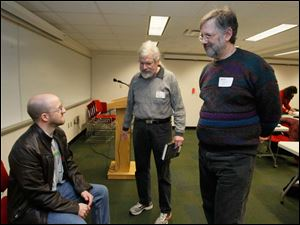 Author Jim Hines, left, with John Bell, of Toledo, center, and Paul Kemner, of Pemberville.  Author Jim Hines is the guest speaker at the Northwest Ohio Writers' Forum at the Way Public Library in Perrysburg, Ohio.