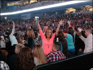 Fans were ready for Luke Bryan after the second band had played.  Singer Luke Bryan in concert in Toledo.