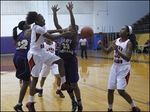 Rogers' Sasha Dailey passes the ball past Waite's Taylor Works to Akienreh Johnson.