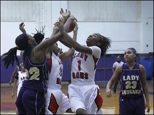 Rogers' Sasha Dailey (1) grabs a rebound.
