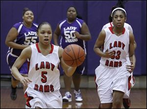 Rogers' Keyanna Austin dribbles the ball down court in transition late in the game.