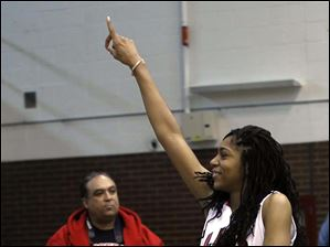 Rogers' Marquelle Williams signals her team's rank in the City League after defeating Waite.