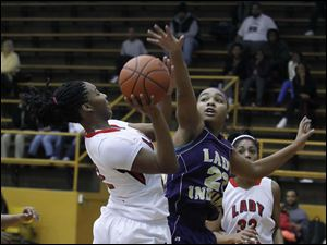 Rogers' Tatyana Reynolds shoots over Waite's Taylor Works.
