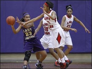 Waite's Taylor Works looks to get the ball past Rogers defenders.