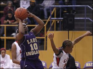 Waite's Ramiah Henry shoots as Rogers' Cha'Ron Sweeney looses her balance.