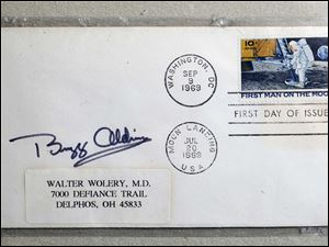 A first day cover signed and canceled by astronaut Buzz Aldrin on the moon on July 20th, 1969, is on display.