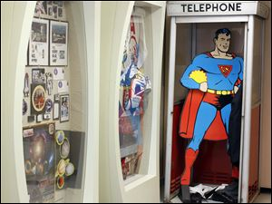 A display features Postal items celebrating NASA, the United States Postal cycling team and Superman.