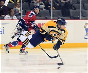The Walleye's Joey Martin goes airborne to make a pass in Saturday's game against Kalamazoo at the Huntington Center.