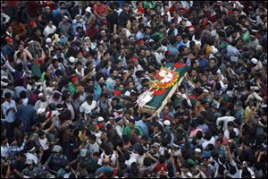 Bangladeshi mourners carry the coffin containing the body of blogger Rajib Haider, 30, for funeral services today in Dhaka, Bangladesh.