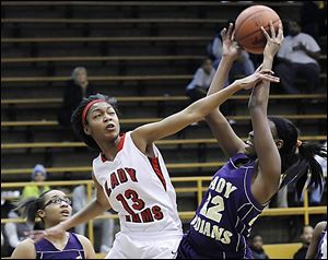 Roriana Easley of Rogers defends against Janae Kenny of Waite in Saturday's City League final.