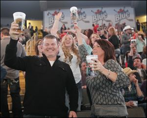 Duane and Katrina Parsell of Findlay raise their glasses prior the Luke Bryan concert Friday at the Huntington Center in Toledo.