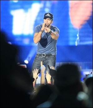 Singer Luke Bryan entertains the crowd, which was on its feet, in Toledo.