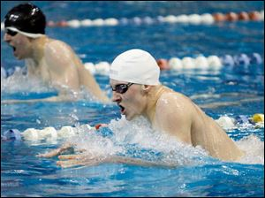 St. Francis De Sales swimmer Christian Sobczak, right, competes in the 200 yard individual medley.