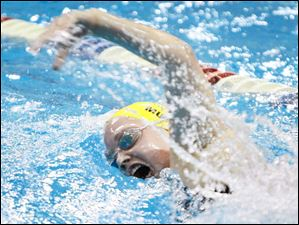St. Ursula Academy swimmer Mikayla Murphy takes a breath on her way to winning the 200 yard individual medley.