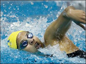 St. Ursula Academy swimmer Zhada Fields competes in the 200 yard freestyle at the Division I Northwest District swim meet.
