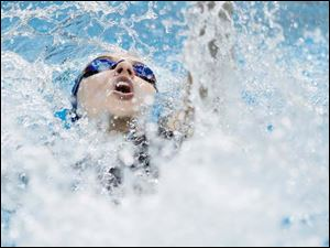 Notre Dame Academy swimmer Spenser Kale swims the backstroke portion of the girls 200 yard medley relay at the Division I Northwest District swim meet.