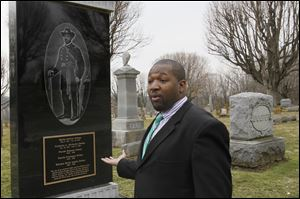 Roderick Blount stops by the tombstone of Martin Delany, who rests at the center of the cemetery outside Wilberforce, Ohio. Former Toledo Mayor Jack Ford was among those who helped  raise money for the marker.