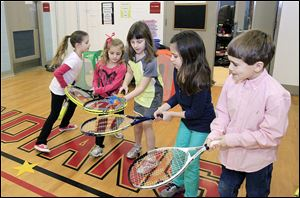 Practicing the 'passing the worm drill' are Lacey Powell, left, first grade; Allison Shadle, kindergarten; Justice George, second grade; Lucy Murra, second grade, and Lucas Dake, second grade.