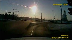 In this photo from a dashboard camera, a meteor streaks through the sky over Chelyabinsk, Russia.