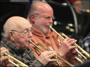 Edwin Knepper, of Walbridge, left, and Marek Moldawski, of Maumee, are members of the Owens Community College Concert Band.