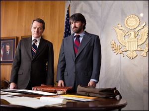 "This film image released by Warner Bros. Pictures shows Bryan Cranston, left, as Jack O'Donnell and Ben Affleck as Tony Mendez in ""Argo,""  a rescue thriller about the 1979 Iranian hostage crisis."