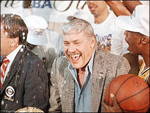 Los Angeles Lakers owner Jerry Buss celebrates the 1987 championship.
