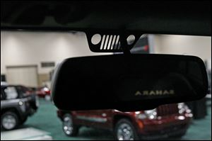 """Easter Egg"" details on the new Jeep Wrangler include a small decal of the front grill on the inside of the windshield."