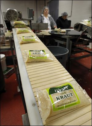 Bags of Frank's Kraut come off the line at the Fremont Co.
