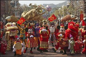 Mickey mouse and other cartoon characters pose during a parade as celebrating the Chinese New Year in 2008.