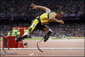Paralympic superstar Oscar Pistorius was charged Thursday, Feb. 14, 2013, with the murder of his girlfriend who was shot inside his home in South Africa, a stunning development in the life of a national hero known as the Blade Runner for his high-tech artificial legs.