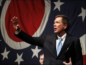 Ohio Gov. John Kasich waves after giving his speech.
