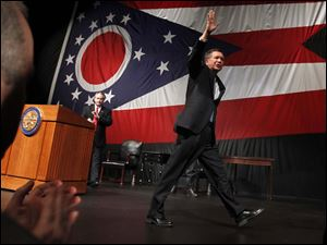 Ohio Gov. John Kasich waves goodbye as he walks off stage.