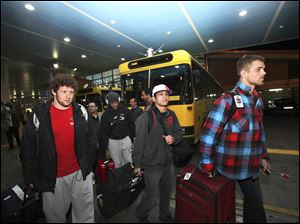 U.S. freestyle wrestling team members arrive at the Imam Khomeini airport in Tehran, Iran, early today to attend World Cup tournament.