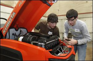 Pettisville High School students Nathan Betz, left, and Dexter Aeschliman competed in last year's competition.