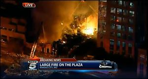 In this image taken from video from KCTV, firefighters battle a massive fire today at Country Club Plaza in Kansas City, Mo.