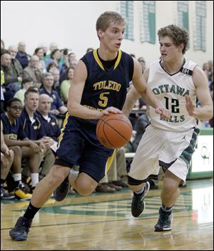Toledo Christian's Eric Cellier drives against Ottawa Hills' Judah Wollenburg. Cellier leads the Toledo Area Athletic Conference with a 21.7 scoring average.
