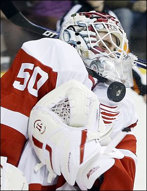 The Red Wings' Jonas Gustavsson blocks a shot in the second period. He had to replace starter Jimmy Howard, who left in the first with an upper-body injury.