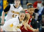 Toledo's Naama Shafir steals the ball from Northern Illinois player Alicia Johnson.