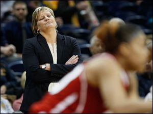 Even though her team was up by double digits in the second half, University of Toledo coach Tricia Cullop was displeased as she watched the Rockets play the NIU Huskies.
