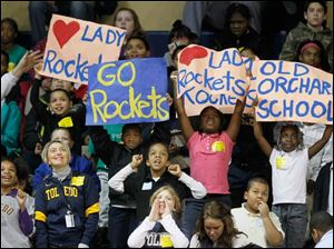 Students  from Old Orchard School in Toledo cheer for the Toledo Rockets as they battle Northern Illinois University on Rocket Women's Basketball Educational Day at Savage Arena.