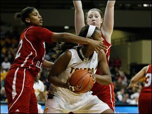 Toledo's Yolanda Richardson is guarded by Northern Illinois defenders Natecia Augusta, left, and McKenzie Hoelmenn.