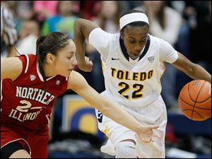 Toledo's Andola Dortch heads up the court after stealing the ball from Northern Illinois player Amanda Corral.