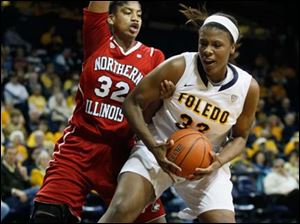 Toledo's Yolanda Richardson tries to get past Northern Illinois' Natecia Augusta.