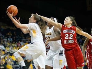 Toledo's Naama Shafir goes to the basket against Northern Illinois' Amanda Corral.