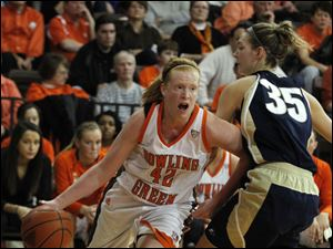 BGSU's Danielle Havel dribbles around Akron's Carly Young.