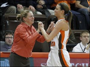 BGSU head coach Jennifer Roos greets Chrissy Steffen on her way to the bench at end of game.