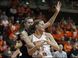 Akron's Rachel Tecca knocks the ball out of the hands of BGSU's Jill Stein.