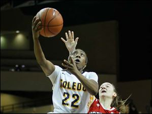 Toledo's Andola Dortch puts a up a layup in front of Northern Illinois's Alexis Lindstrom.