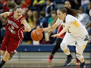 Toledo's Naama Shafir steals the ball from Northern Illinios' Alexis Lindstrom during the second half.