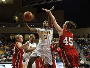 Toledo's Lecretia Smith puts up a shot against Northern Illinois' McKenzie Hoelmenn.